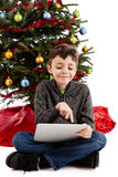 Child playing on Tablet PC at Christmas Stock Photography