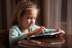 Child playing on tablet Stock Photos