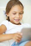 Child playing on tablet pc Royalty Free Stock Image