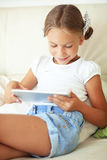 Child playing on tablet pc Stock Images