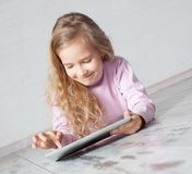 Child playing with tablet pc Stock Photography