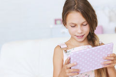 Child playing with tablet pc Stock Image