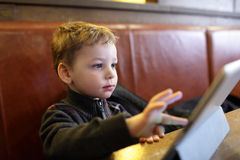 Child playing on a Tablet PC Royalty Free Stock Images