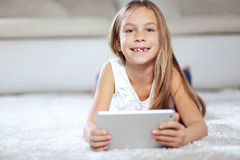 Child playing on tablet pc Stock Image