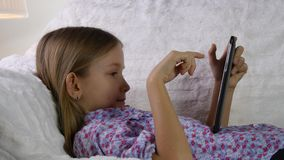 Child Playing Tablet PC on Sofa, Girl Portrait, Internet Searching, Studying 4K stock footage