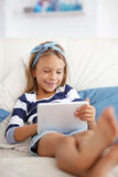 Child playing on tablet pc Stock Photo