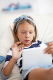 Child playing on tablet pc Stock Photos