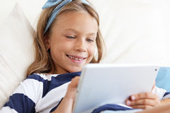 Child playing on tablet pc Royalty Free Stock Photo