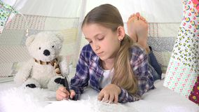Child Playing Tablet in Playroom Girl Writing Homework for School Kid Playground.  stock video footage