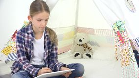 Child Playing Tablet in Playroom Girl Writing Homework for School Kid Playground.  stock video