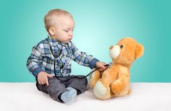 Child playing with teddy bear Royalty Free Stock Photography