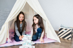 Child playing with a teepee royalty free stock image