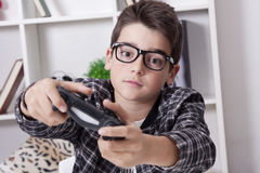 Child playing with teh video games. Child at home playing with the video games or game console Royalty Free Stock Image