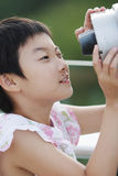Child playing telescope Royalty Free Stock Photography