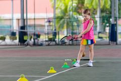 Free Child Playing Tennis On Outdoor Court Royalty Free Stock Images - 138993189