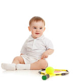 Child playing with tennis racket and ball. Adorable child floor and playing with tennis racket and ball over white background Stock Image