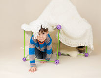 Child Playing with Tent, Fort Stock Photo