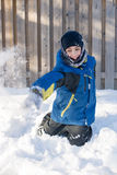 Child Playing Throwing Snow in Winter Stock Photos