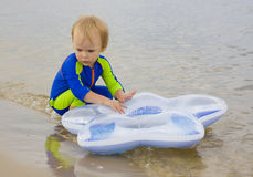 The child, playing to water Stock Image
