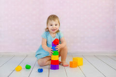 Child playing together. Baby play with blocks. Educational toys for preschool and kindergarten child. Little girl build Stock Photo