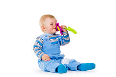 A child playing with a toy Stock Image