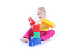 Child playing with toy. Studio shot royalty free stock image