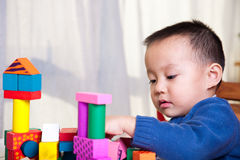 Child playing with toy blocks Stock Image