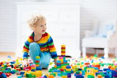 Child playing with toy blocks. Toys for kids stock photography