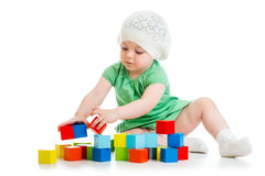 Child playing toy blocks on white background Royalty Free Stock Image