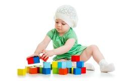 Child playing toy blocks on white background royalty free stock image