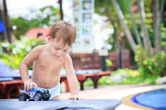 Child playing with toy car Royalty Free Stock Photography