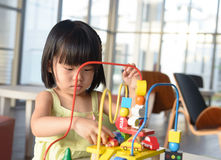 Child playing toy Royalty Free Stock Photo