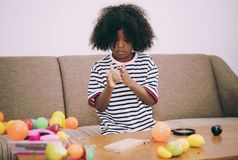Child playing toy in the living room stock photos
