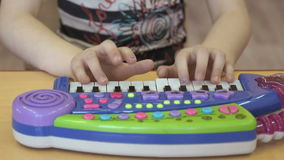 Child playing on a toy pianoforte at kindergarten stock footage