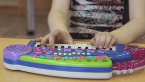 Child playing on a toy pianoforte at kindergarten stock video footage