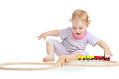 Child playing with toy railroad Royalty Free Stock Photo