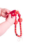 Child playing with a toy: sling necklace Royalty Free Stock Photos