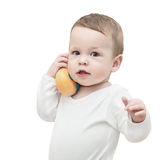 A child playing with a toy telephone Royalty Free Stock Images