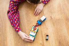 Child playing with toy truck. Royalty Free Stock Images