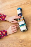 Child playing with toy vehicle. royalty free stock photo