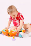 Child playing toys. A child playing toys on a light  background Royalty Free Stock Image
