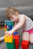 Child playing with toys Stock Image