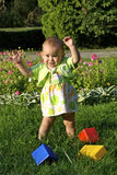 Child playing with toys. Child playing on a grass Stock Images
