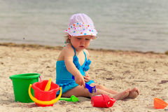 Child playing with toys at beach Royalty Free Stock Image