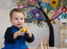 Child playing toys Stock Images