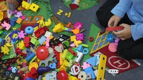 Child playing with toys stock footage