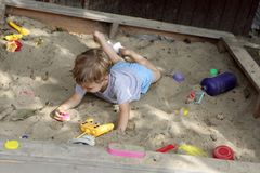 Child in sandbox. Child playing with toys in a sandbox Royalty Free Stock Photos