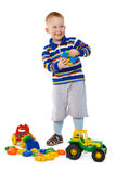 Child playing with toys on white background Stock Image