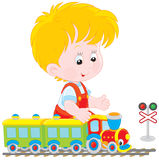 Child playing with a train vector illustration