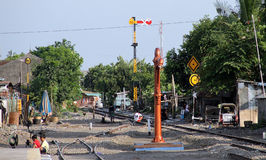 Child playing on train tracks at the station Sangkrah solo Central Java Indonesia Stock Images